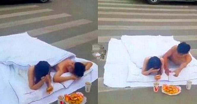 """为拍婚纱照一对男女竟躺斑马线上""""滚床单"""""""